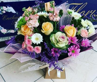 Aqua Bouquet side view - seasonal flowers in a mix of soft dreamy pastel colours.