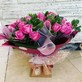 Aqua bouquet with a mix of bright hot pink roses & foliage's.