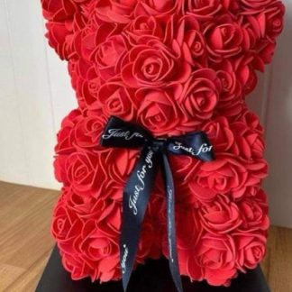 Red Rose bear with a black ribbon bow.