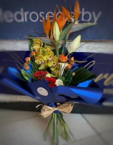 A mix of exotic flowers handtied together in a blue wrap