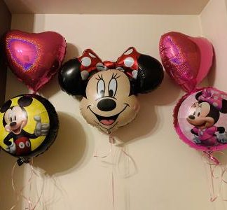 Two pink heart balloons, one round Minnie balloon, one round Mickey balloon & a large Minnie character face.