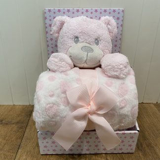 Baby pink teddy with a blanet presented in a box with a pink bow.