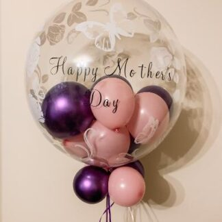 Clear bubble balloon with butterfly detailing. Filled with pink & purple balloons