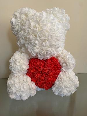 Cream bear with a red heart on tummy.