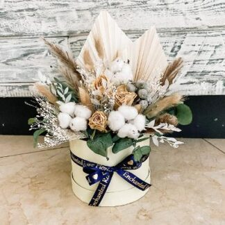 Cream hat box filled with stunning rustic dried flowers & foliage in neutral tones.