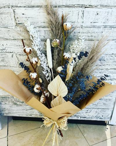 Dried Bouquet including Pampas, Eucalyptus & Cotton. All handtied together in brown paper with a rustic bow.