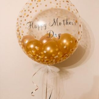 Gold confetti bubble balloon filled with rose gold & gold mini balloons. Finished with a white organza bow.