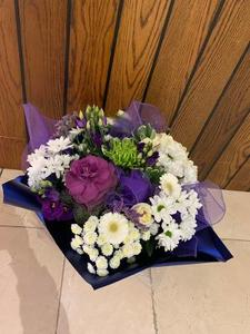 Close view showing seasonal mixture of flowers in purple & white