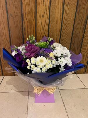 Large aqua bouquet showing a mix of seasonal flowers in purple & white. Presented in a lilac aqua box with bow