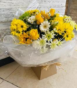 closer view of yellow seasonal flowers in bouquet. Including yellow roses & daisies