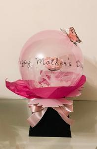 Pink bubble balloon with a pink artificial rose inside. Presented in a box with a pink bow & pink decorative butterfly.