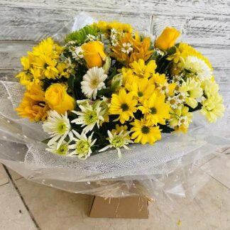 Large Aqua bouquet showing a mix of yellow seasonal flowers.